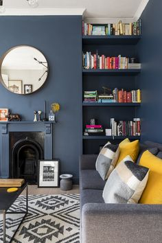 Dark blue walls by Farrow & Ball, lifted with yellow velvet cushions and alcove . - Dark blue walls by Farrow & Ball, lifted with yellow velvet cushions and alcove shelving housing a - Dark Living Rooms, Living Room Color, Blue Rooms, Living Room Shelves, Room Interior, Living Room Diy, Living Room Wall, Living Room Grey, Blue Walls Living Room