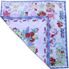 quilt made of vintage tablecloth squares, backed by a repro tablecloth