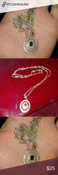 Beautiful Sapphire and tri-colored gold necklace Very pretty sapphire necklace the chain is tri-colored gold over silver 18 inches slight wear on the clasp, used to wear it a lot the pendant is gold over silver sapphire and very pretty Jewelry Necklaces