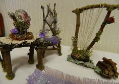 love the fairy harp with twined rose, trimmed with moss, mounted on bark  ... woodpile is cute - posts on back of chair are nice  *********************************************  snowdrop58 via flickr #fairy #miniature #harp