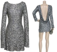 Ana dancing dress in Aspen----silver, short & backless #FiftyShades @50ShadesSource www.facebook.com/FiftyShadesSource