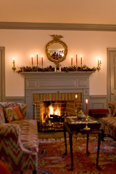 Country Federal style sitting room at Xmas. Love the traditional way of painting the woodwork  (incl windows) and mantle a darker colour than the walls.