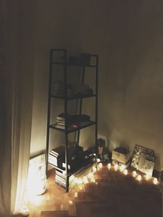 My cozy corner created with 80 lei (less than 20$). I repurposed a kitchen shelf, rearranged the objects I owned, bought some pretty baskets, photo frames and those magic lights and I got this :)