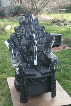 The Throne of Nerds is made in honor of the Throne of Swords from the Game of Thrones TV series and fantasy series. It is constructed from 20+ computer keyboard mounted to a chair. The keyboards and have been shaped and melted to follow the form of the chair, the shape of the user, and to meld together into a combined whole.