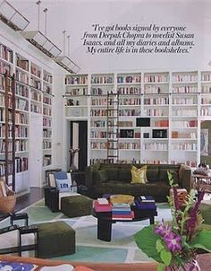 I want a similar library. In the quote on the wall, something about stories taking you away and letting you experience the lives of the characters you meet.