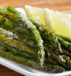 asparagus... toss the asparagus with 1 tbsp. olive oil and fresh squeeze of lemon. Place the stalks in a baking dish and roast until they're al dente, 350 for 10 minutes. Sprinkle with parmesan cheese bake till golden. So yummy!