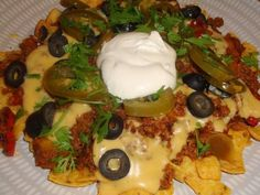 Vegan nachos, with vegan melted cheese sauce and vegan sour cream!! All from The Gentle Chef cookbook and The Non Dairy Formulary cookbook by Skye Michael Conroy