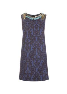 Michael Williamson: The Uber Collection is proud to feature this designer on our favourites list. This day dress is perfect for a business lunch, casual drinks, or just meeting a friend on the high street!  The Jacquard effect is definitely in key with this season's baroque theme, and the neckline is as decadent as a day dress gets!