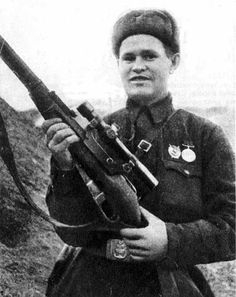 Russian renowned sniper Vasily Zaytsev posing with his Mosin-Nagant sniper rifle, Stalingrad, Russia, Oct 1942