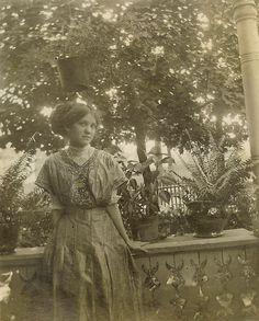 Hidden Magnolias:  Beautiful woman posing on the porch