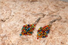 Colorful earrings made of beads and wire by LaKosta on Etsy, €9.00