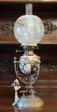 A Doulton Burslem brass mounted porcelain oil lamp, English,… - Lamps - Kerosene - Lighting - Carter's Price Guide to Antiques and Collectables