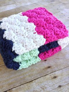 This beautiful crochet blanket is super cheerful in bright pink, mint, navy and white chunky stripes  It measures approximately 30 x 25- perfect for a newborn baby girl or as a lap blanket for anyone who loves color and warmth  All of my blankets are carefully stitched in 100% premium soft acrylic yarn. They are simple to care for by machine washing in cold water on gentle cycle and tumble dry on low heat  All items for sale in my shop are made by me in my clean, smoke free shop Check out…