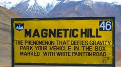 Magnetic Hill at 14,000 feet above sea level is located about 30 kilometres off the gorgeous town of Leh, India. It is said to have magnetic properties strong enough to pull stationary cars uphill at a speed of around 20 km/hr.  Know more places to visit in Ladakh. #JammuAndKashmir | #India | #Ladakh