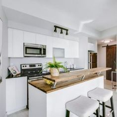 Bright Corner Suite Of 673 Square Feet. Undermount Sink, Stainless Steel Appliances, West Lake, Counter Top, Square Feet, Kitchen Island, Condo, Home Decor, Island Kitchen
