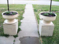 Shoestring Pavilion: Tire planters with cinder block plinth