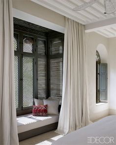 The window seat in Merckoll's mother's bedroom has pillows made from vintage kilims, and the curtains are linen