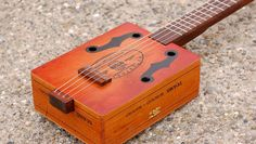 Family Fun: How to Make a Guitar Out of a Cigar Box Acoustic Guitar Lessons, Acoustic Guitar Strings, Acoustic Guitars, Guitar Girl, Guitar Case, Eric Clapton, Cigar Box Guitar Plans, Bass Guitars For Sale, Buy Cigars Online