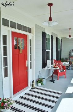 Red front door and cute porch