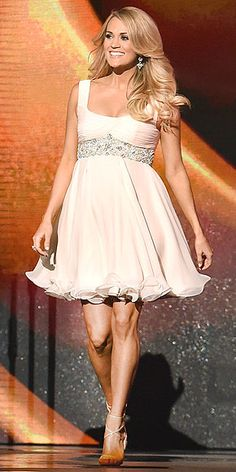 She may be expecting a boy (thanks for the tip, co-host Brad Paisley!), but the star herself was all girl in her blush-pink Randi Rahm baby doll dress and Brian Atwood sandals.