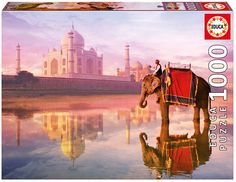 Elephant At Taj Mahal is a gorgeous jigsaw puzzle featuring a man atop a bold elephant, in the river outside. The stunning reflection in the river is truly a work of art, and ties the whole puzzle together. Perfect for framing and hanging in your home!