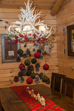 Eclectic dining room with it's antlers chandelier dressed for Christmas, by Whitney Lyons