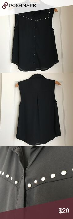 Black Studded Collar Sleeveless Top 100% polyester. Perfect for the summer! Button down in the front. Purchased from Nordstrom awhile ago. Some loose threads near buttons, but not noticeable when buttons are buttoned. See photos. Worn a few times. Tops