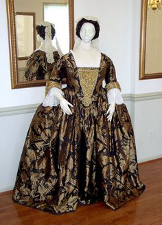 "This dramatic outfit began with a rich black and gold silk damask, in a large floral pattern of the 1740's, and is a closed robe, or ""Round"" gown. A matched set of embroidered cuffs and stomacher, created in gold bullion, ribbons, sequins and trimmings are based on an original set (in silver) in the Snowshill collection, England. Gown is styled after a portrait of Mrs.Charles Willing, by Feke and decorations after a portrait of Lady Frances Byron, 1733, by J.Highmore."