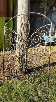 Wrought iron butterfly gate from CB Ornamental Steelwork and Metal Art.