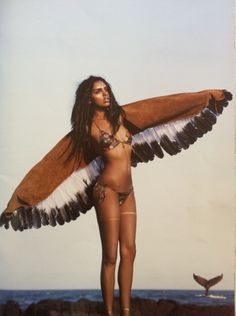 Girl with wings on the seaside indian summer babe