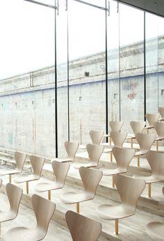 Auditorium : Maritime Museum of Denmark, Helsingør Denmark (2013) | BIG : Bjarke Ingels Group | Custom made Seven-chairs by Arne Jacobsen (original model FH 3107 designed in 1955)