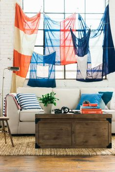 Get The Look: Nautical Living Room >> http://photos.hgtv.com/rooms/viewer/living-space/hanging-vintage-flags-above-living-room-sofa?soc=pinterest