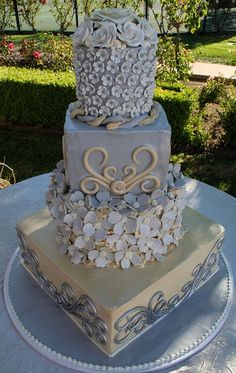 Floral Elegance    Tiered wedding cake with all edible gumpaste & white chocolate flowers. Cory & Elin