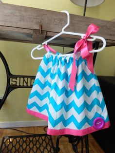 This cute baby girl summer dress in chevron print is super cute and practical for the warmer months. This dress has a cute ribbon neck line which ties into a bow on one side, which allows you to adjust the dress to fit your bub super easy.