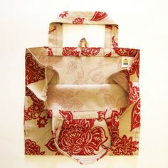 A lovely deep red floral print design decorates the tan background of this reusable grocery shopping bag.  Made from a washable cotton & polyester blend woven fabric, the bag has a seamless, reinforced bottom and fully enclosed side seams.  The handles are strong but gentle on your hands and ...