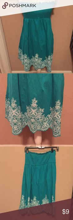 Love Rocks Teal Tube Top Mini Dress Size L This is such a cute dress! its just a tad to big on me! It's a dark teal color with a beautiful butterfly filigree pattern on the bottom. The bust of the dress is elastic so can fit multiple bust sizes. Except sadly a 32B/36B! Sits mis thigh. I am 5'4. Would be cute as a bathing suit cover! Love Rocks  Dresses Strapless