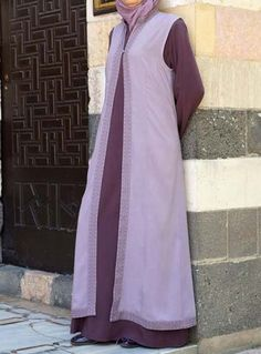 Afifa 2-Piece Abaya Save 44% Plum color  Look like royalty in our beautifully-crafted 2-piece Afifa Abaya, designed with a queen in mind. This stand out piece is perfect for festive nights and would make a regal, eye-catching outfit for a special day. The simple dress is a great staple for every wardrobe, and the top embroidered layer can be worn separately, adding traditional flair to any outfit.