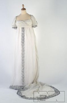 Trained Dress of White Muslin with Black Embroidered Garlands, Early 1800s.
