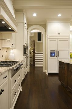 light cabinets, dark floors