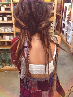 Brunette dreads with wraps and beads