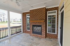 The Delmont #ModelHome, #screenedporch, #outdoorfireplace,  #outdoorliving