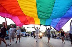 Attend a pride parade in a big city.