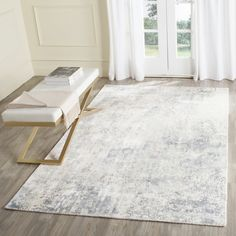 Safavieh Hand-Knotted Mirage Modern Watercolor Aqua Rug (6' x 9') $529.99
