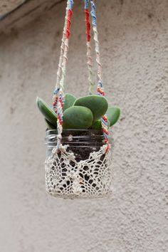 great tutorial how to take doilies to make hangars to hold jars of succulents. Use glass insulators instead of jars