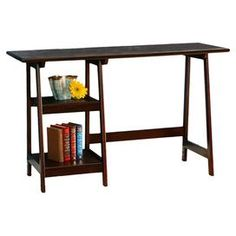 "Bring harmony to your workspace or office with this espresso-hued desk, showcasing a trestle base and 2 open shelves.  Product: DeskConstruction Material: Engineered wood, veneers and hardwoodColor: EspressoFeatures:A-framed legs Two shelvesDimensions: 29"" H x 47"" W x 20"" DAssembly: Assembly required"