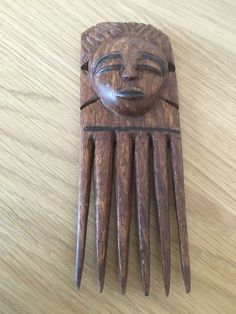Lovely Hand Carved Wooden African Inspired Combe