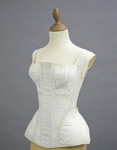early 19th century cord quilted stays, white cotton with embroidered detail