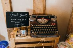 Typewriter guestbook and chalkboard signs  Image by Babb Photo - A vintage inspired rustic outdoor wedding with pastel colour scheme