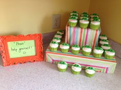 """A """"Sweet Peas"""" themed shower for my SIL's twins!! Cupcake tower, made out of box lids, covered in wrapping paper. Cupcakes designed by my friend Michelle!"""