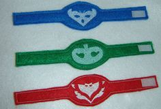 Super cute wristband featuring your three favourite bedtime heroes! PJ Masks Owlette, Gekko, and Catboy. Made from felt, and fasten with